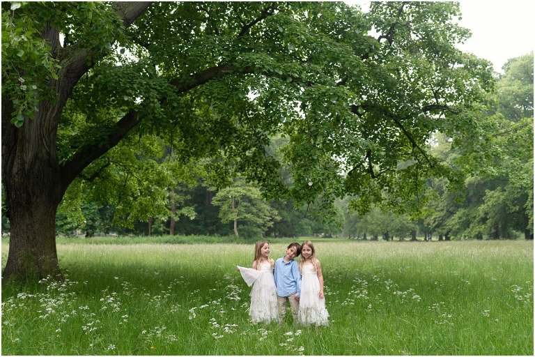Wimbledon family photography - London lifestyle photographer three children under tree