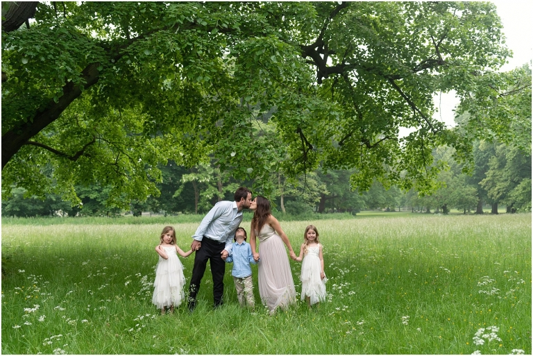 Wimbledon family photography - London lifestyle photographer family kissing in park