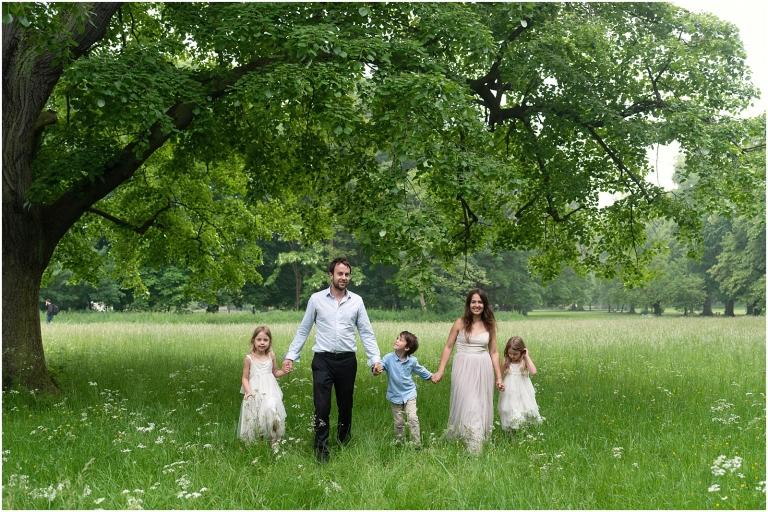 Wimbledon family photography - London lifestyle photographer family walking in park