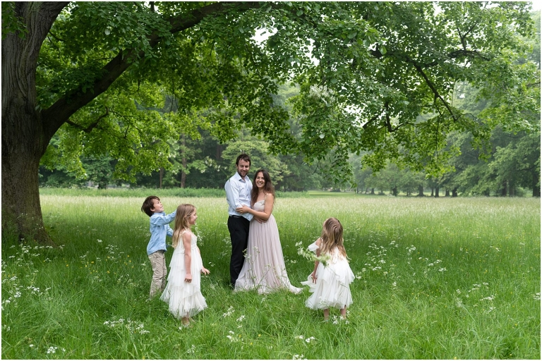 Wimbledon family photography - London lifestyle photographer family playing in park throwing flowers