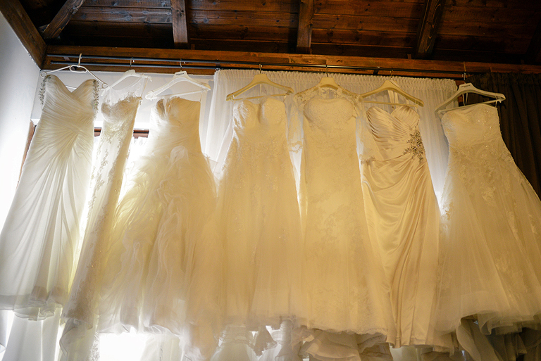 wedding dresses hanging in a hotel room