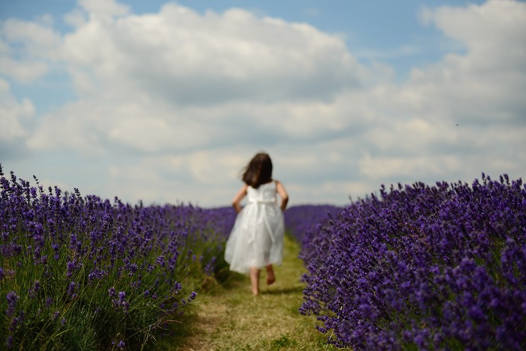 girl running on the field in Mayfield Lavender farm Surrey