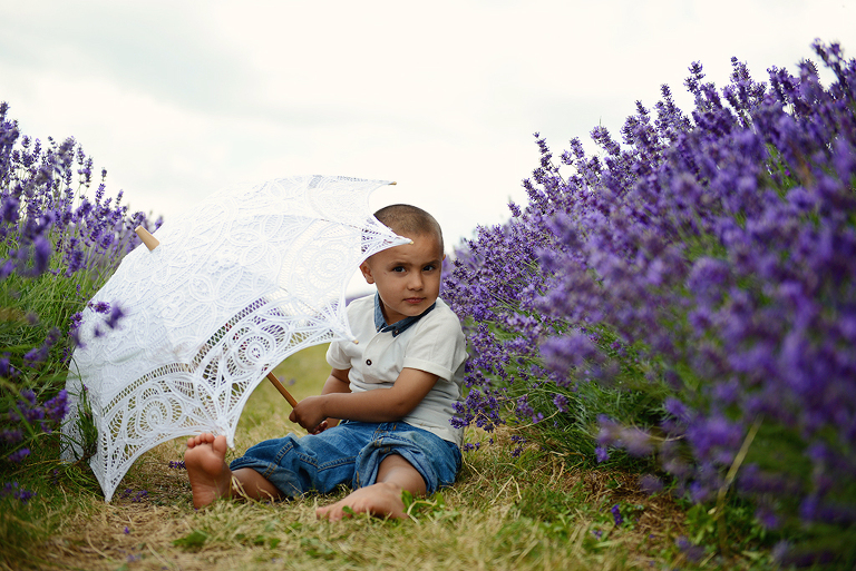 child playing with an umbrella in Mayfield Lavender farm Surrey