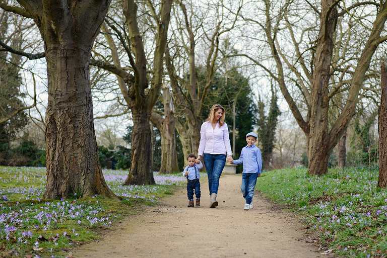mother with two sons walking in Cannizaro Park in Wimbledon