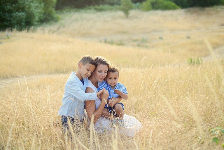 family photography with mother and two sons in a park in Wimbledon