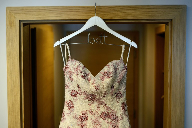 Wedding dress: Geraldine by Sophia Tolli on a hanger