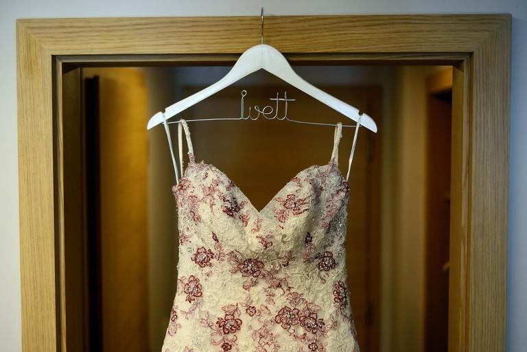 Wedding dress: Geraldine by Sophia Tolli on a hanger