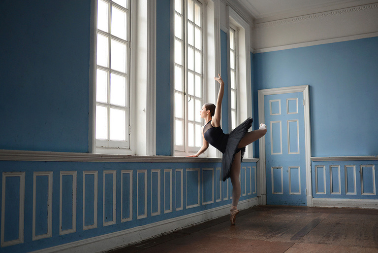 ballerina looking out the window - ballet portfolio photography in Dance Attic London