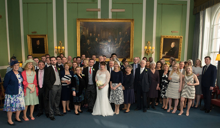 Carlton Club Wedding in London Mayfair - group photo in Churchill Room