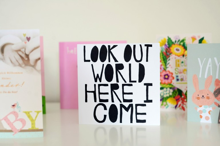 card with 'look out world here I come' text, family photography in Battersea London