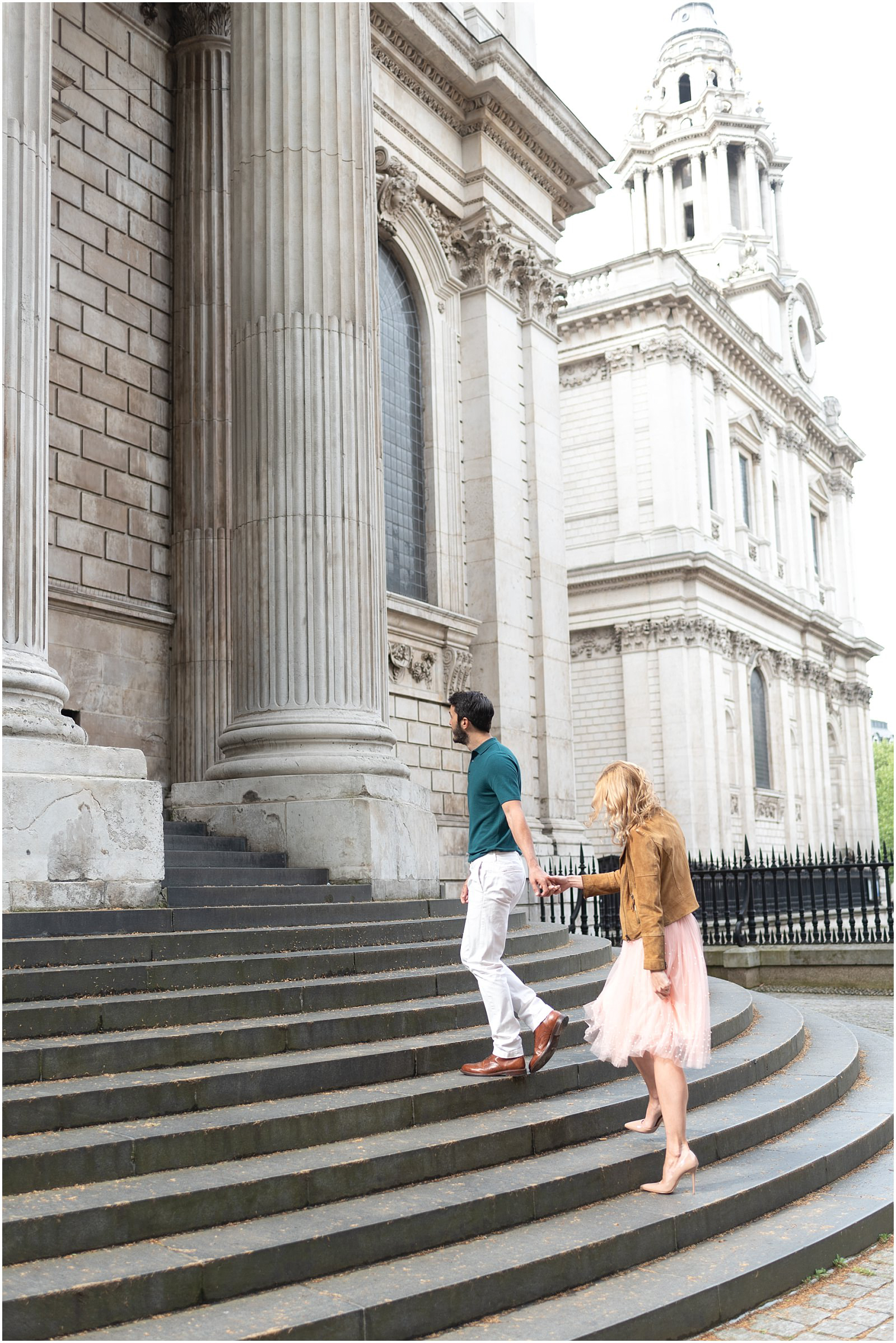 London couple engagement photography st pauls cathedral romantic intimate couple walking up stairs