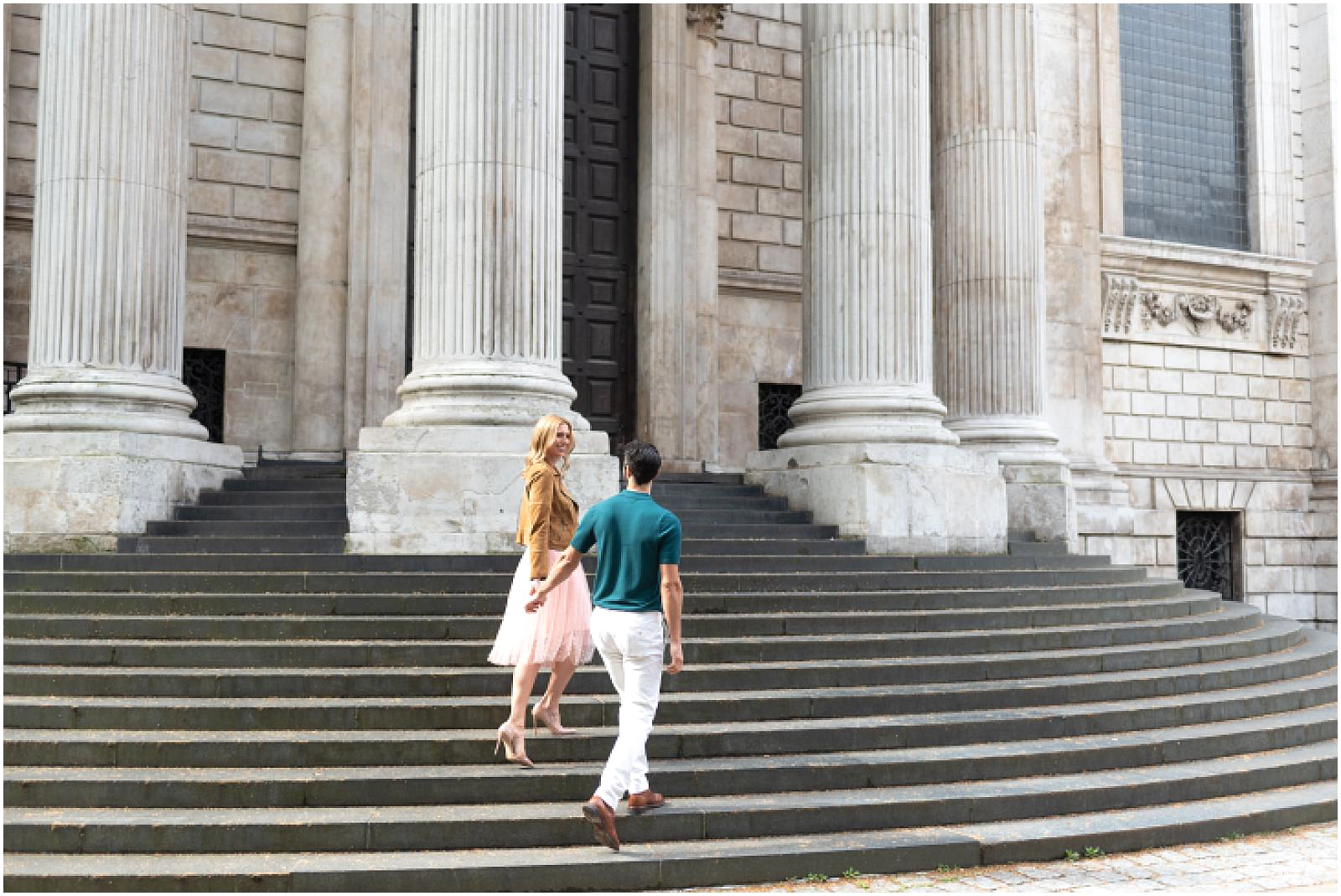 London couple engagement photography st pauls cathedral romantic couple walking stairs
